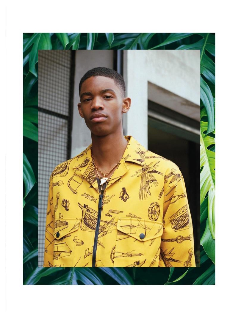 Montell wears ERMENEGILDO ZEGNA shirt and vest, both from a selection; VERSACE shark-tooth necklace £370; HERON PRESTON padlock necklace £245