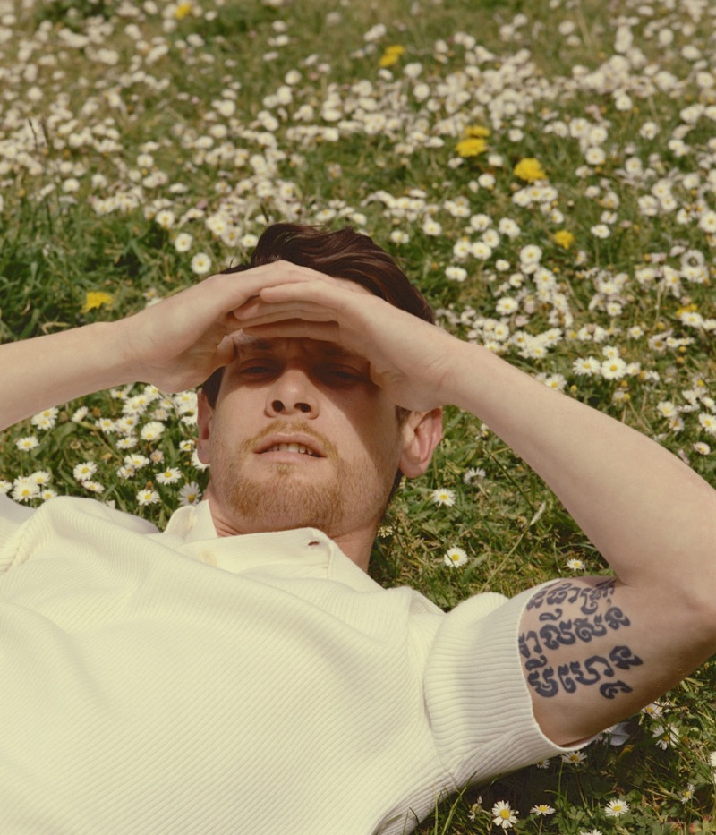 Jack O'Connell dons a textured Sandro polo shirt.