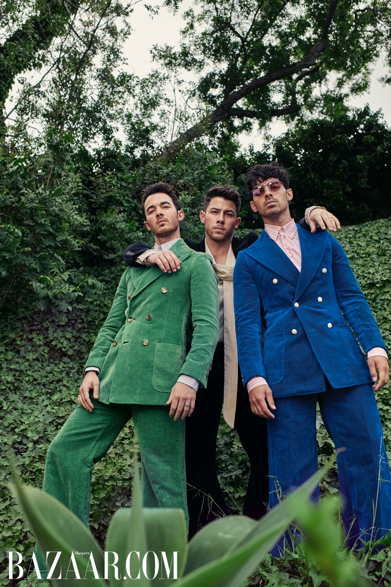 A fashion peacock Kevin Jonas wears a Gucci green suit and blue shirt. Nick Jonas rocks a Gucci black velvet suit and ivory shirt. Rounding out the trio, Joe Jonas wears a Gucci blue velvet suit and stripe shirt.
