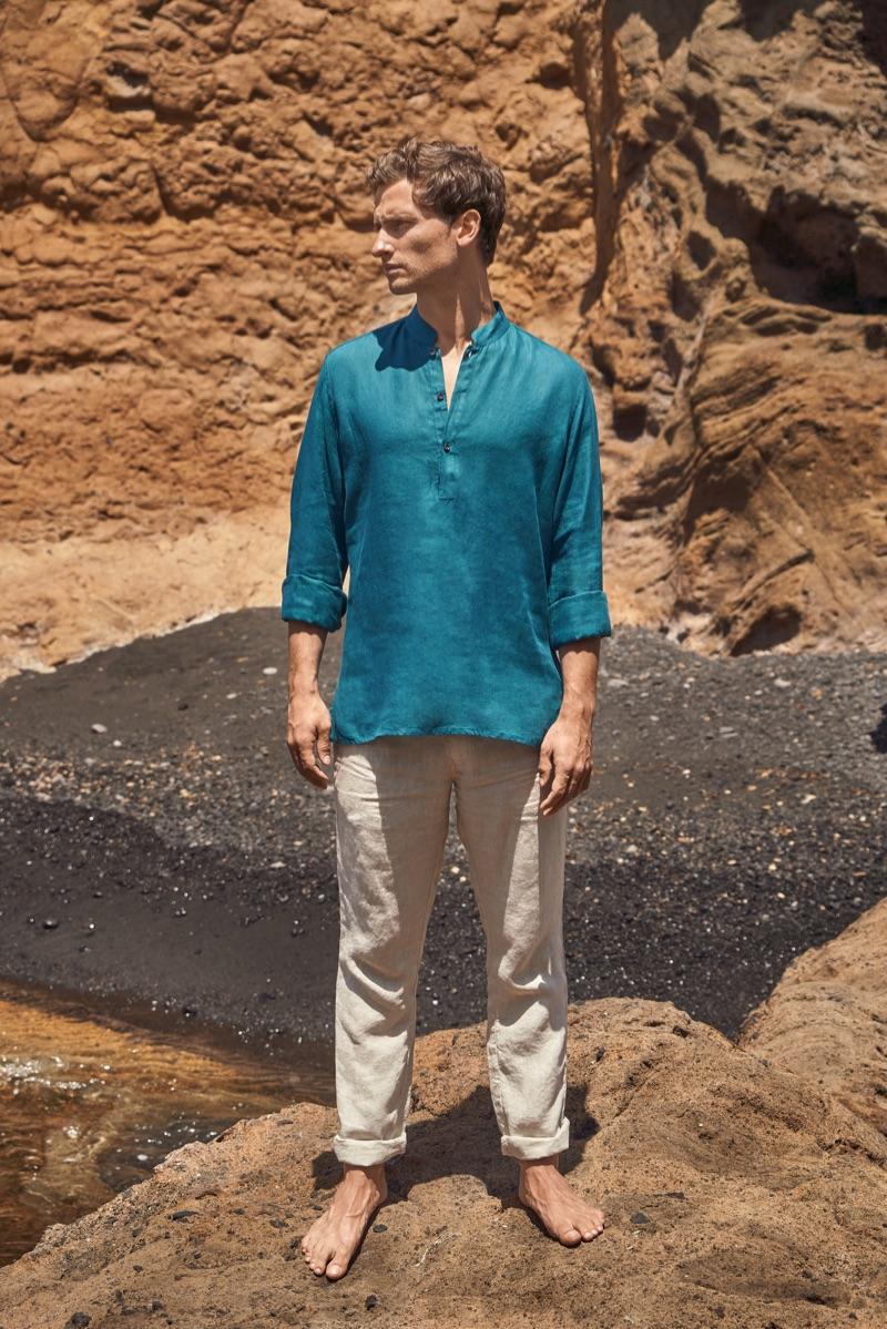 Exploring his surroundings, Tom Warren dons a green Luca Faloni linen shirt.