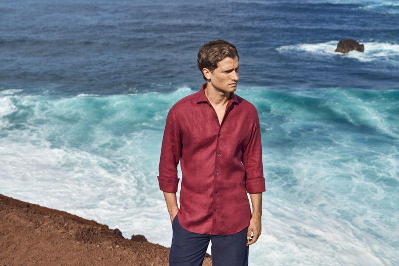 British model Tom Warren wears a red linen shirt for Luca Faloni's summer 2019 campaign.