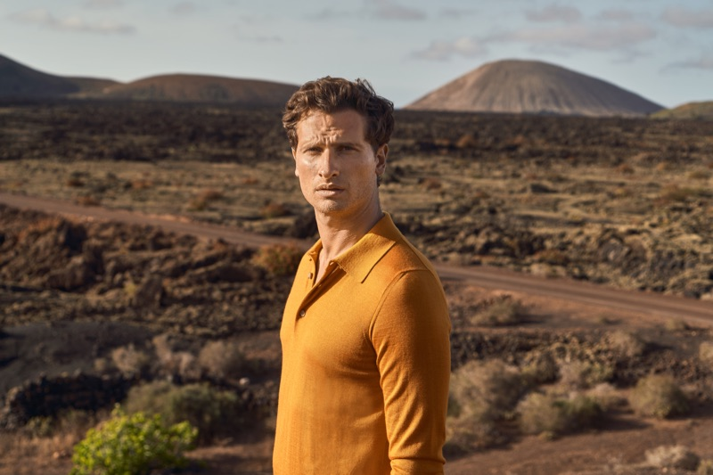 A vision in mustard yellow, Tom Warren wears a silk-cashmere polo for Luca Faloni's summer 2019 campaign.