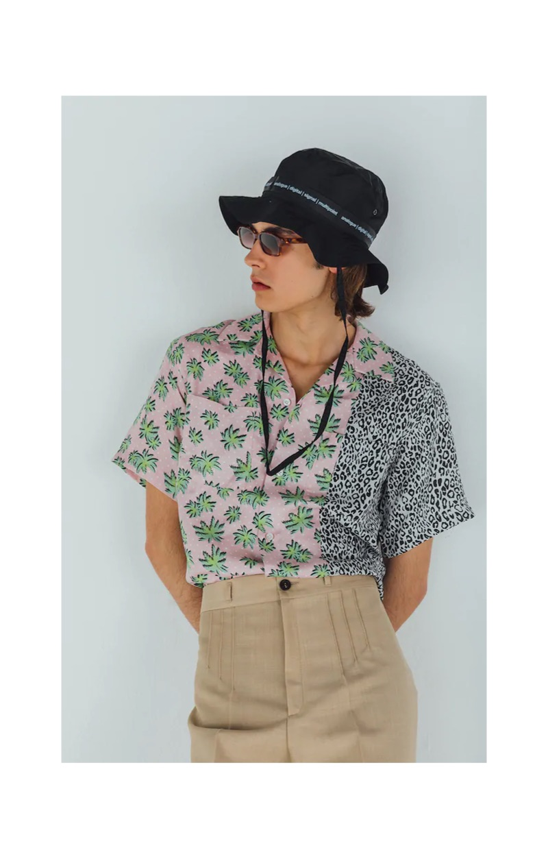 A summer vision, Michele Lanotte models a TDT Tourne De Transmission bucket hat $166, AMIRI palm and leopard print shirt $595, Maison Margiela pleated trousers $696, and Flatlist Eyewear sunglasses $255.