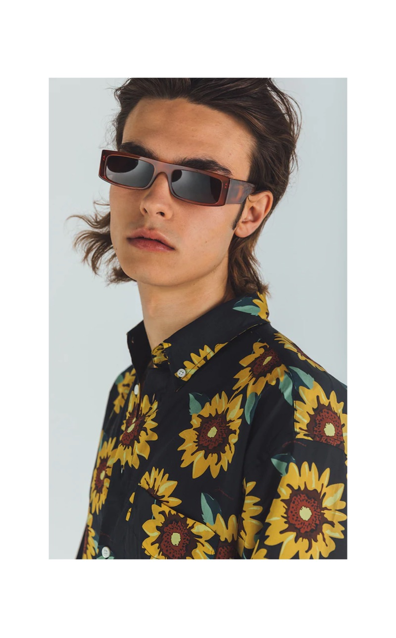 Rocking a Jacquemus sunflower print shirt $217, Michele Lanotte also wears Andy Wolf sunglasses $319.
