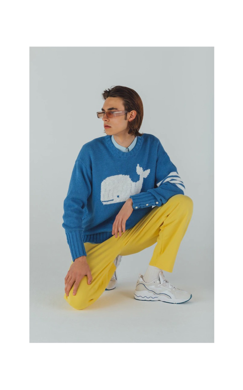 Michele Lanotte dons a Thom Browne sweater with Andy Wolf sunglasses $319, Jacquemus pants $193, and Mizuno sneakers $138.