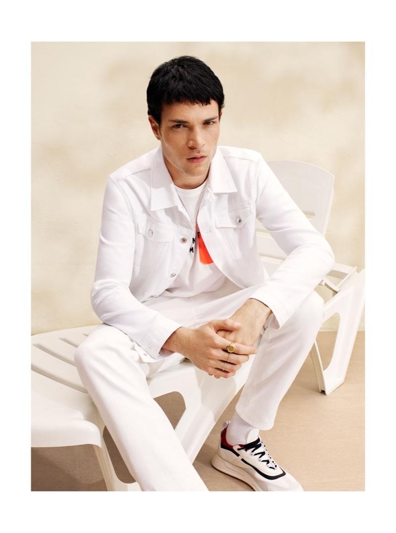Luka Isaac wears a white denim look from Zara Man.