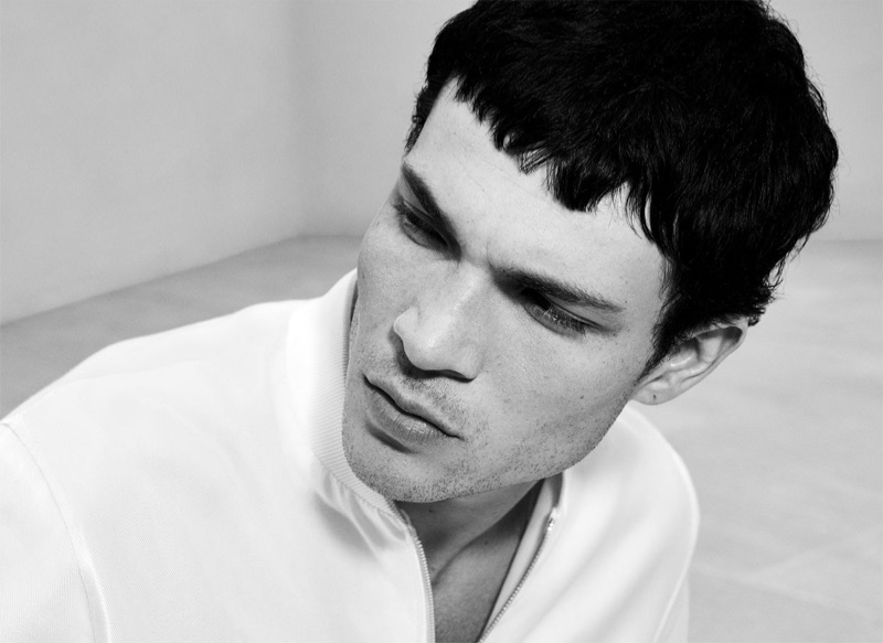 Appearing in a black and white photo, Luka Isaac sports a bomber jacket by Zara.