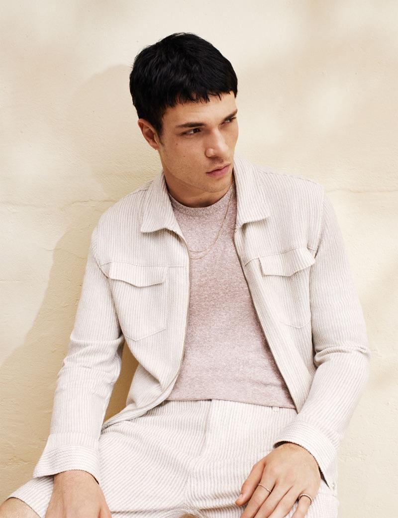 Embracing seersucker, Luka Isaac wears a matching jacket and shorts from Zara.