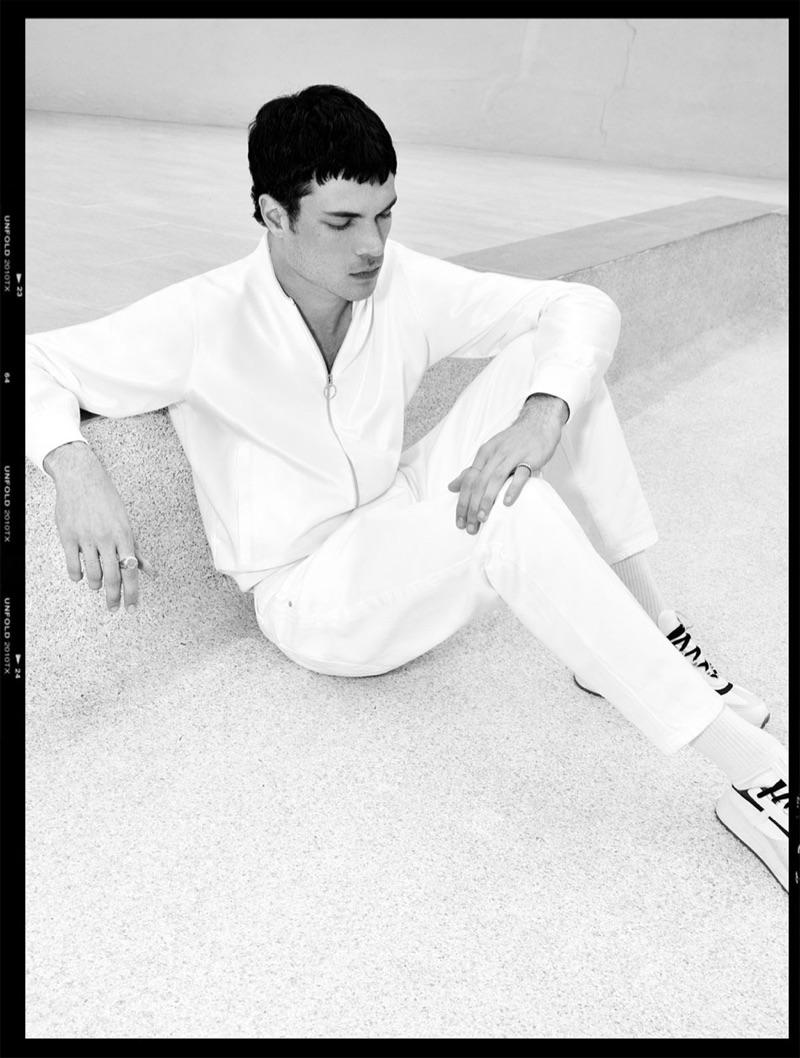 Sporty in white, Luka Isaac rocks Zara.