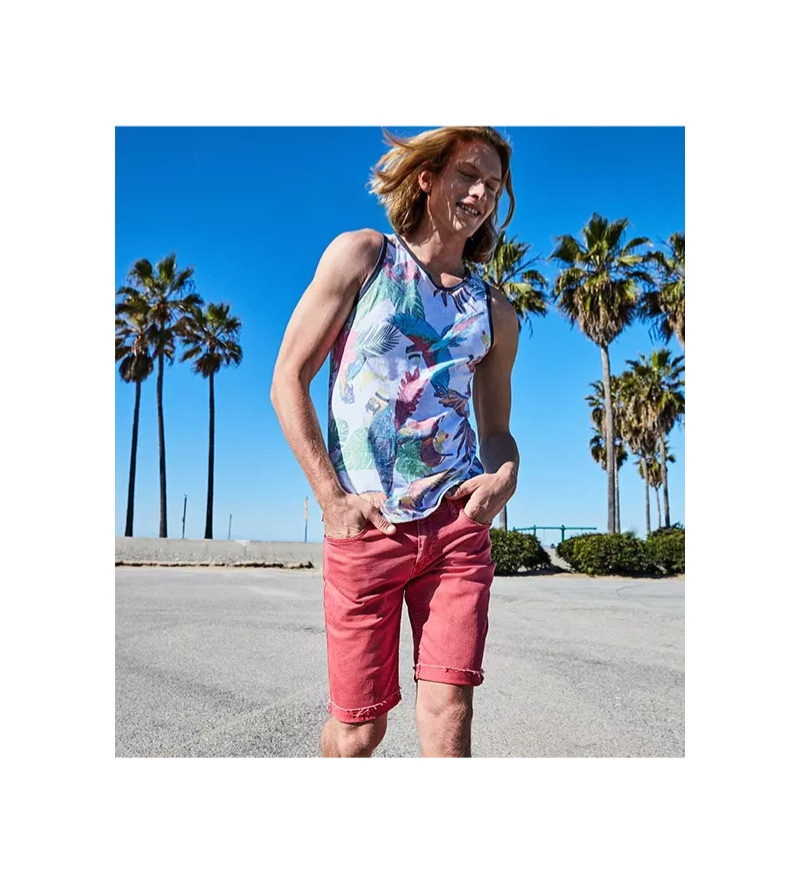 Channeling Cali style, Hunter Bach wears a Levi's bird print tank $34.50 and slim cut-off jeans $50 with Converse Chuck Taylor All Star sneakers $50.