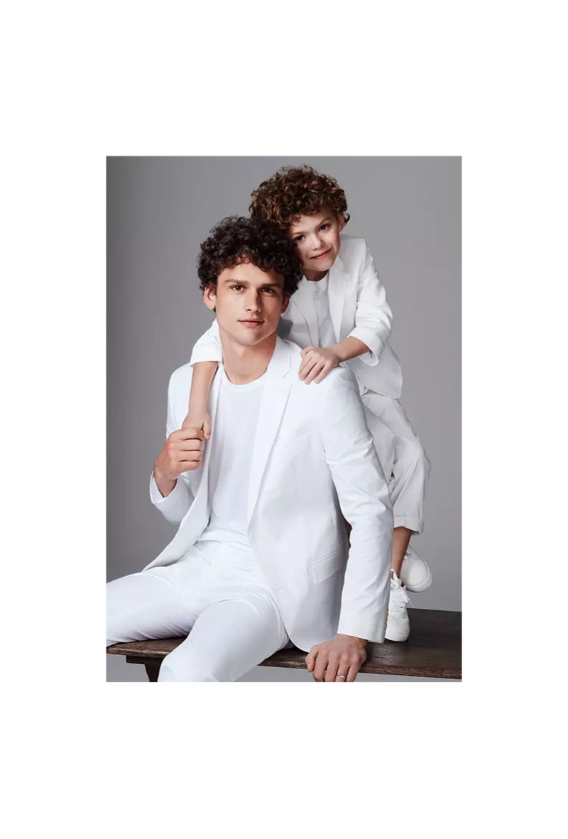 A vision in white, Simon Nessman dons an I.N.C. linen-blend blazer and dress pants.