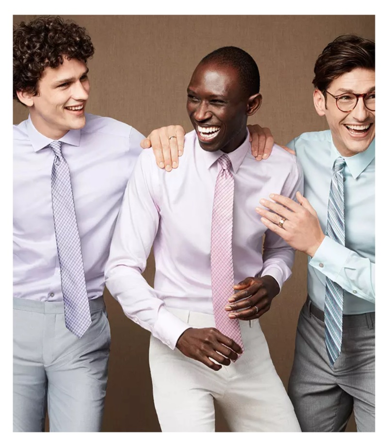 All smiles, Simon Nessman, Armando Cabral, and Parker Gregory wear smart shirts and ties from Macy's.