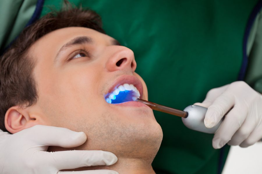 Man Getting Teeth Whitening