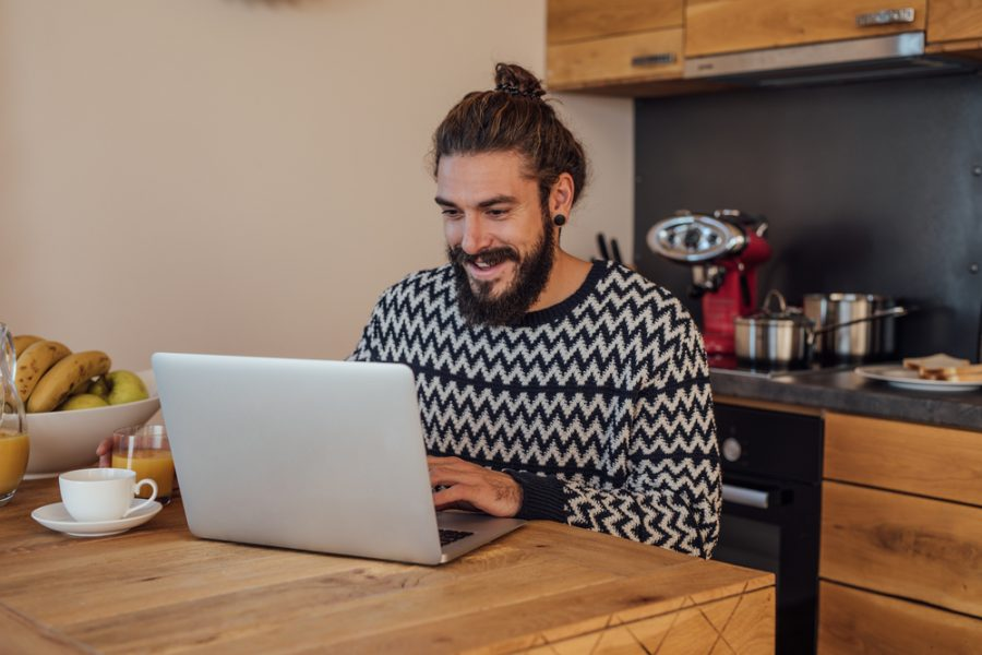 Man with Man Bun on Laptop