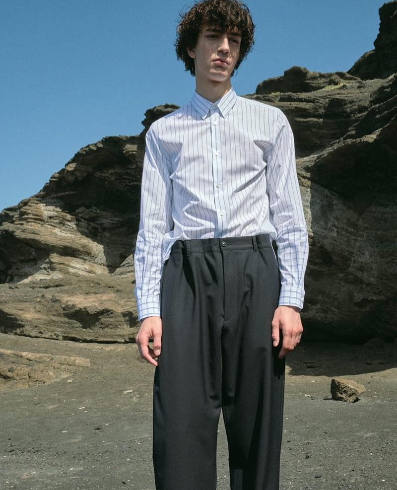 Gena Malinin sports a Stella McCartney striped shirt with Maison Margiela trousers.