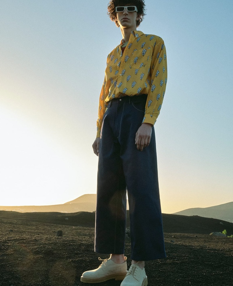 Front and center, Gena Malinin wears a Jacquemus shirt, Craig Green sweater, Marni jeans, AMI shoes, and Andy Wolf sunglasses.