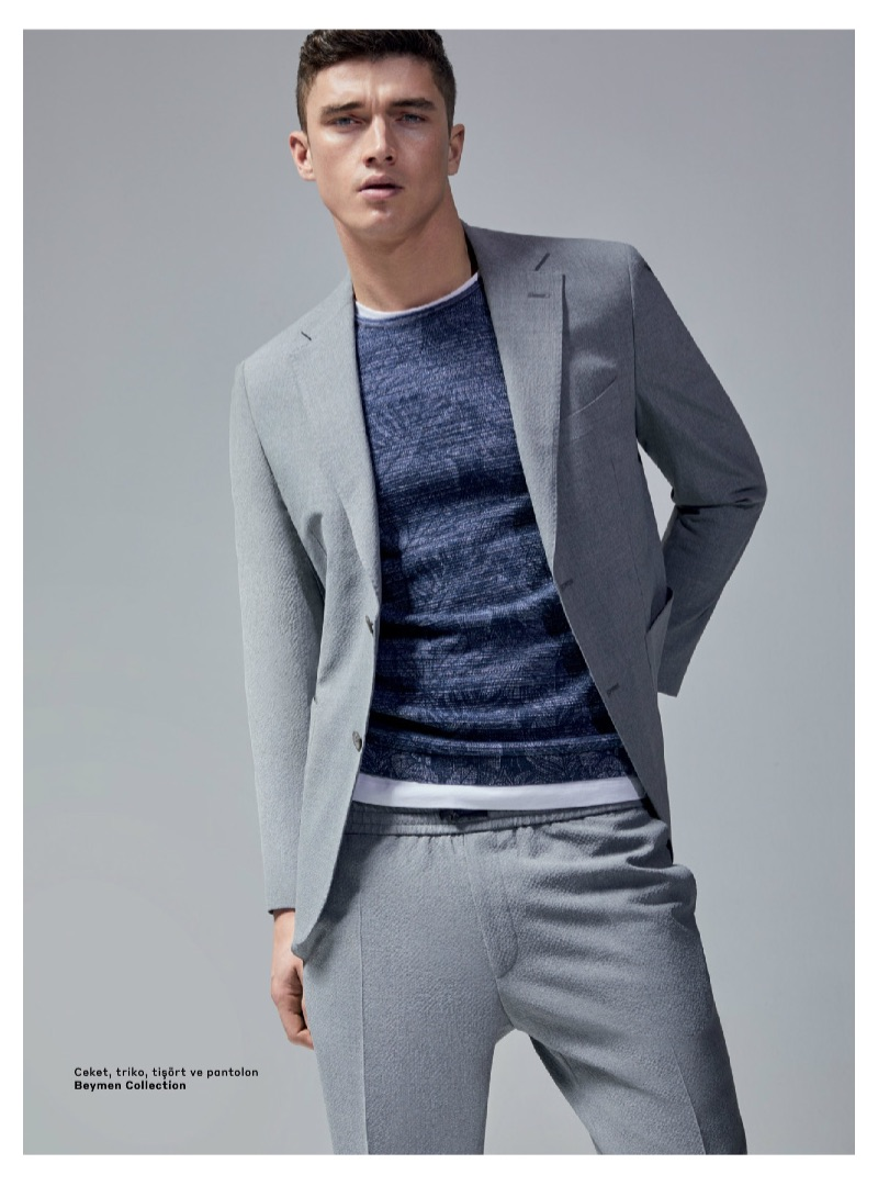 A smart vision, Matthew Holt dons a grey suit from Beymen Collection.