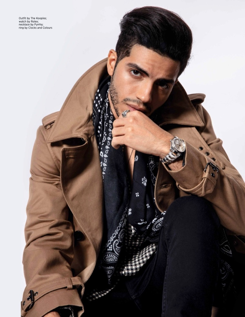 Aladdin star Mena Massoud wears an outfit by The Kooples with a Rolex watch, Pyrrha necklace, and Clocks and Clours ring.