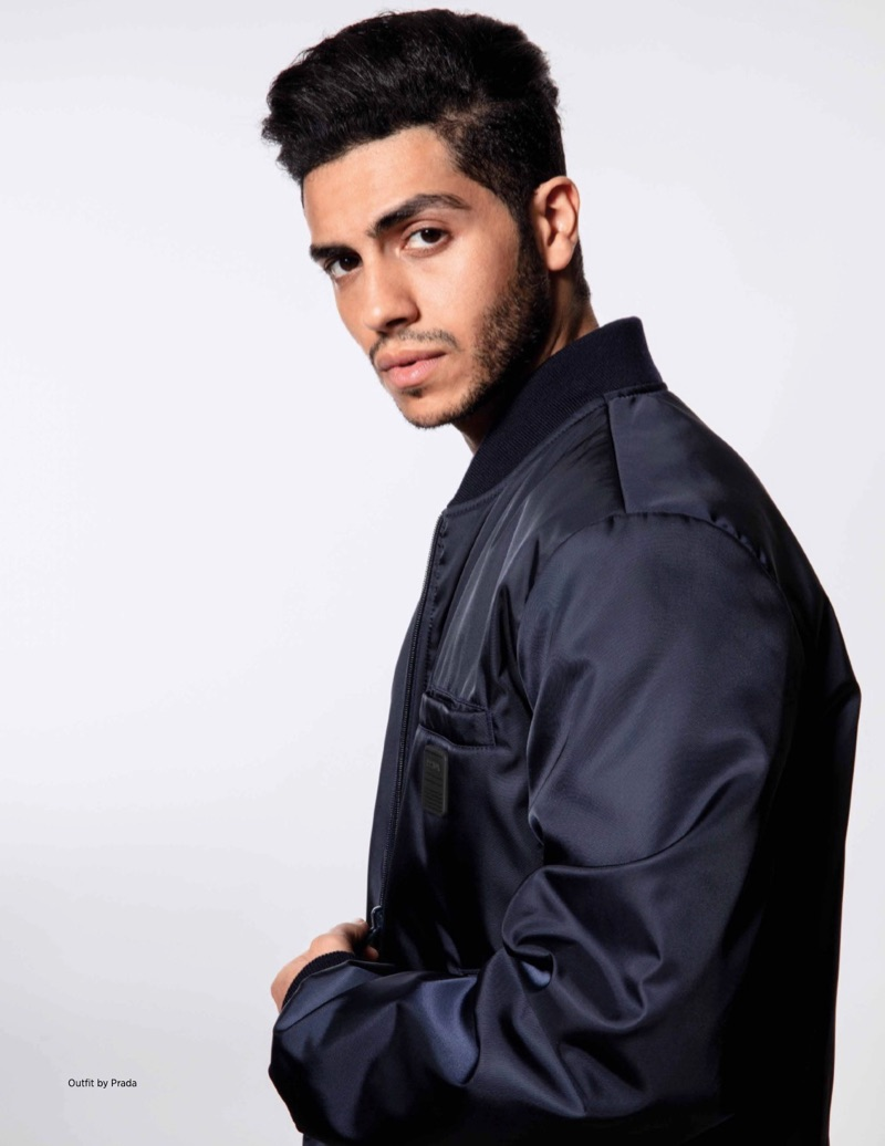 Sporting a bomber jacket by Prada, Mena Massoud stars in a new photo shoot.