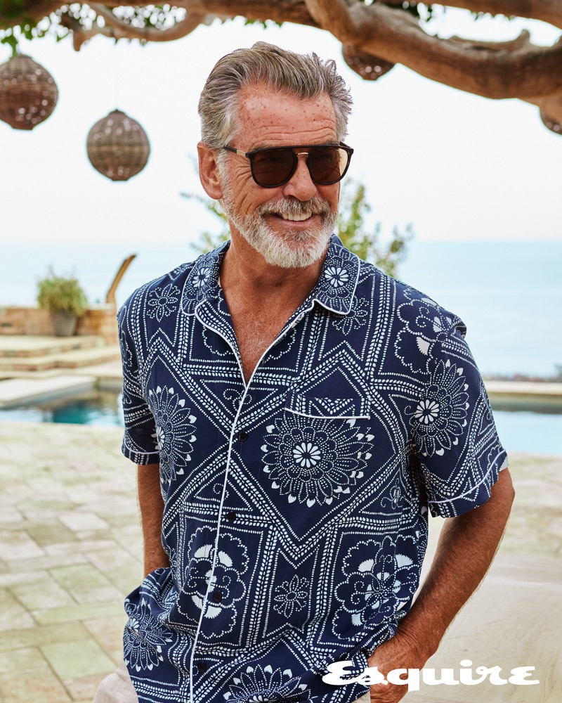 All smiles, Pierce Brosnan wears a Levi's Made & Crafted shirt with ISAIA trousers and Giorgio Armani sunglasses.