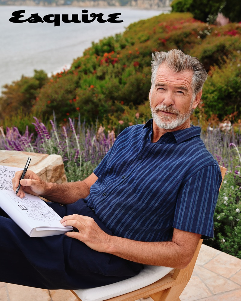 Pierce Brosnan dons a Vince striped shirt with Giorgio Armani trousers.