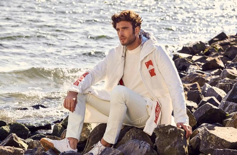 Sporting a monochromatic neutral look, Gaspard Menier brings attention to Scotch & Soda Amsterdams Blauw's cotton-linen coat $345.