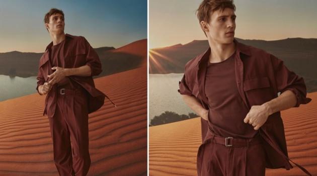 Embracing a monochromatic color scheme, Julian Schneyder models a LE 31 utility jacket, wide-leg pants, piqué cotton t-shirt, and Birkenstock Arizona sandals.