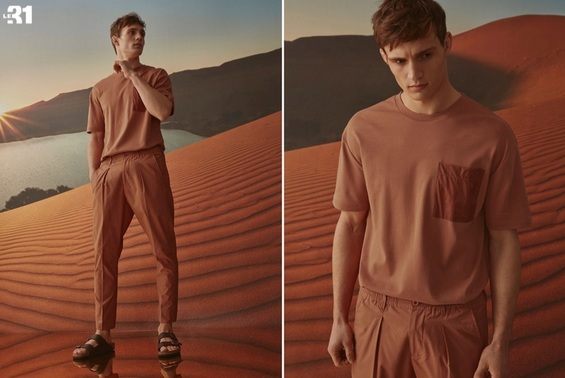 Top model Julian Schneyder wears a LE 31 nylon pocket t-shirt and pull-on pants with Birkenstock Arizona sandals.
