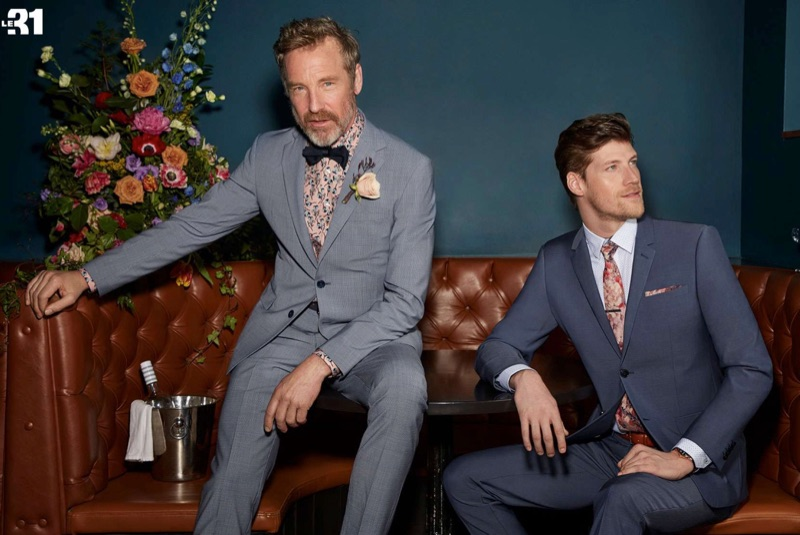 Left: Rainer Andreesen models a LE 31 houndstooth suit with a printed shirt. Right: Alex Loomans dons a LE 31 chambray blue traveler suit with a Blick English garden tie and pocket square.