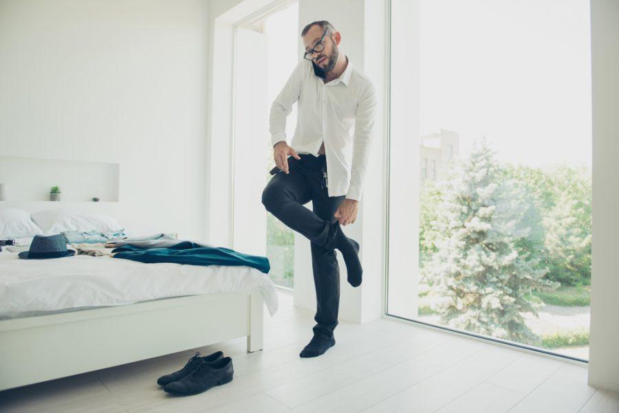 Stylish Man Putting on Socks