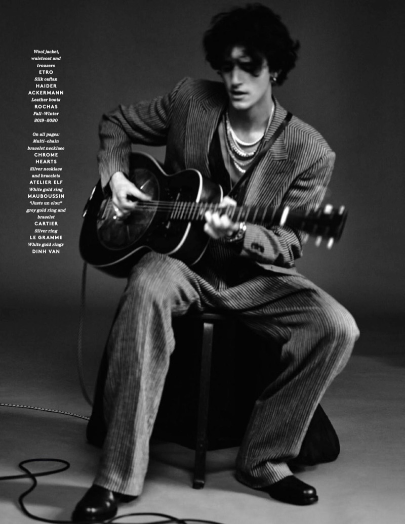 Connecting with Vogue Hommes Paris, Tamino dons a wool jacket, waistcoat, and trousers by Etro. He also wears a Haider Ackermann caftan and Rochas leather boots.