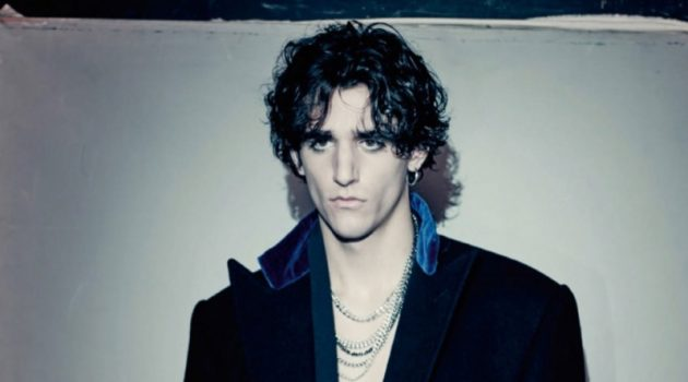 Tamino sports a wool coat by Ralph Lauren Purple Label with a velvet robe from Triple RRR.