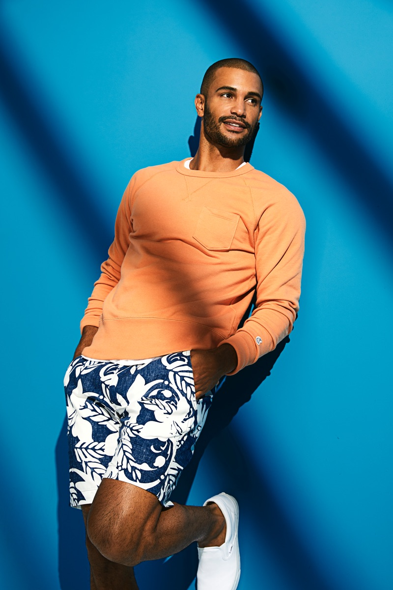 Embracing summer style, Nathan Owens wears Todd Snyder x Reyn Spooner's blue floral shorts $128.