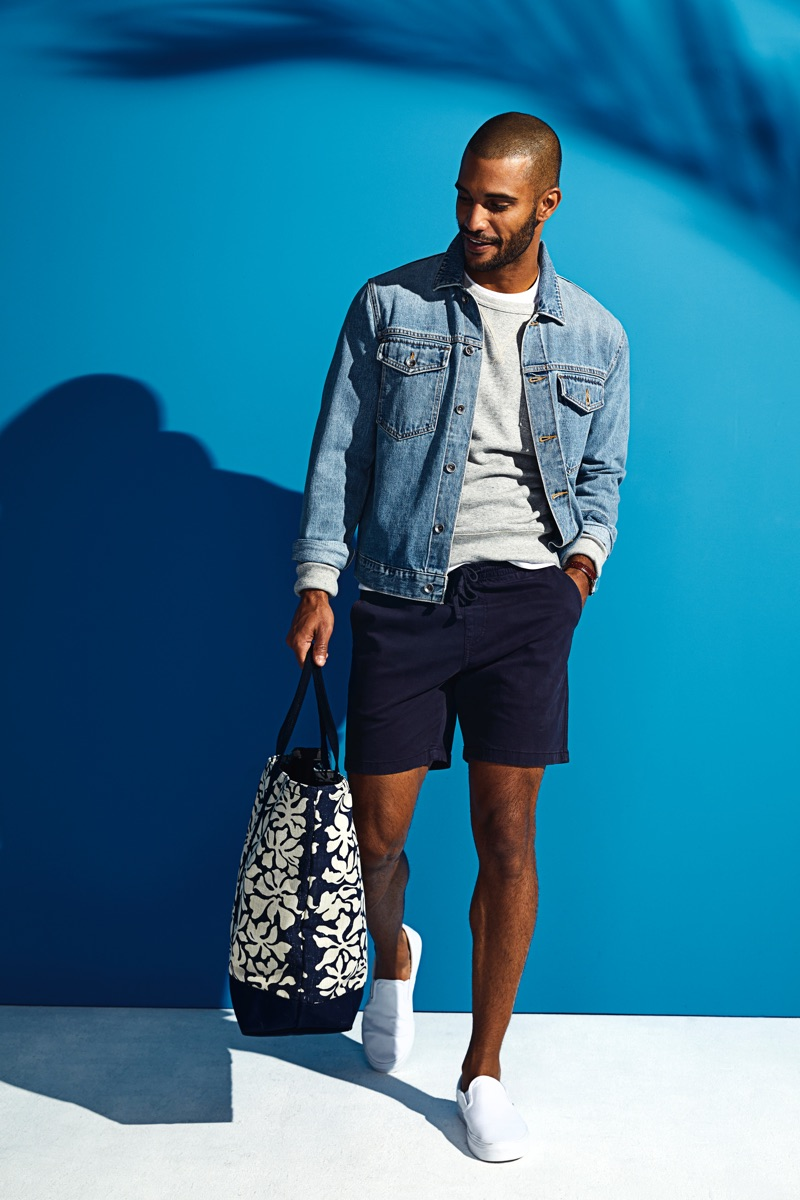 Nathan Owens takes hold of Todd Snyder x Reyn Spooner's Windjammer tote bag $158 in navy.