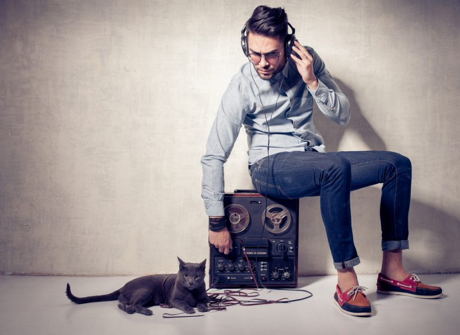 Trendy Man Listening to Music with Cat