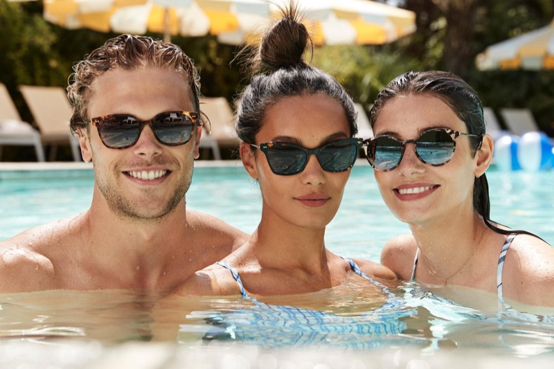 Enjoying an afternoon in the pool, Christopher Mason sports Warby Parker's Tilden tortoise with gold sunglasses.