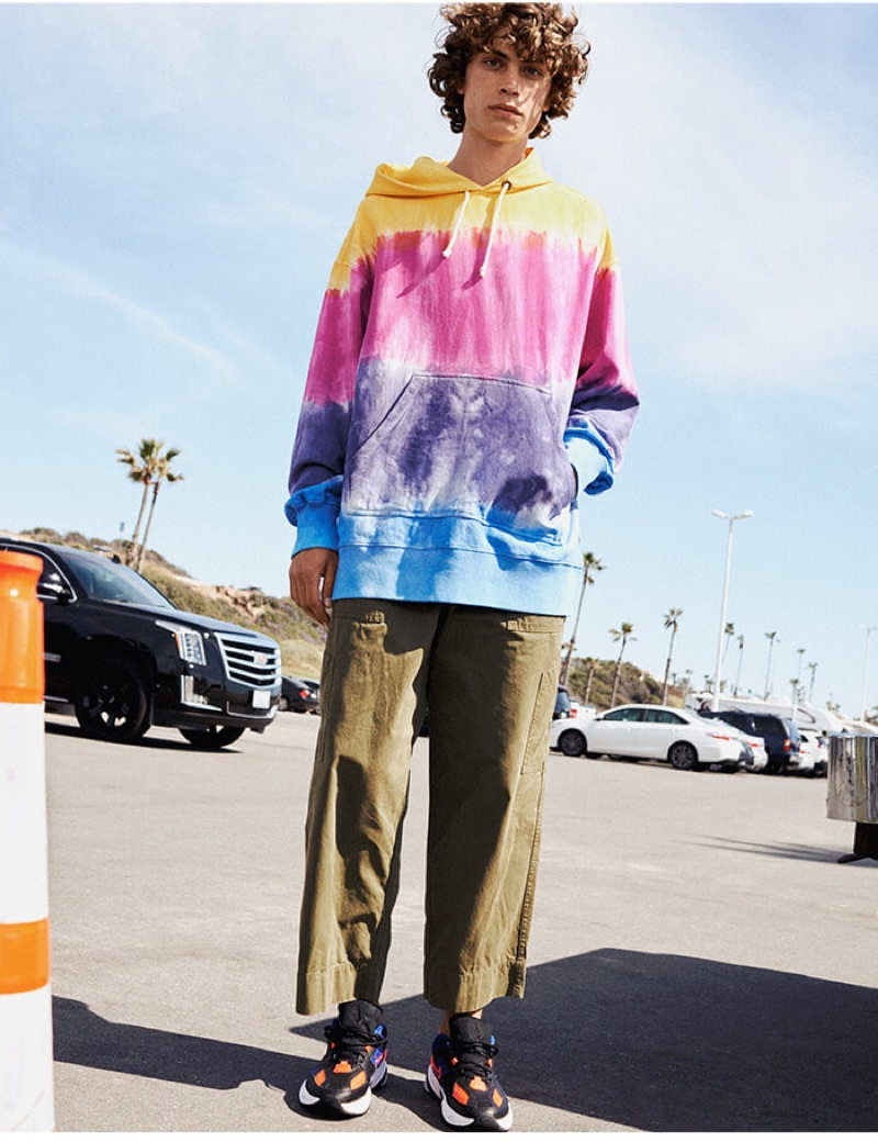 Reuniting with YOOX, Lucas Bin makes a statement in a tie-dye hoodie.