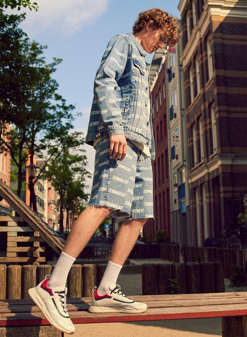 Lemmie van den Berg models printed denim with sneakers from Zara.