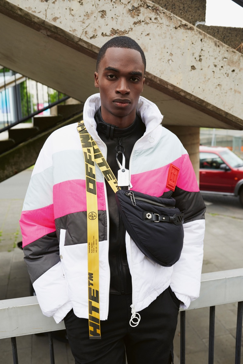 Going sporty, Bakay Diaby wears an Off-White Jacket and belt bag with 7 For All Mankind pants.