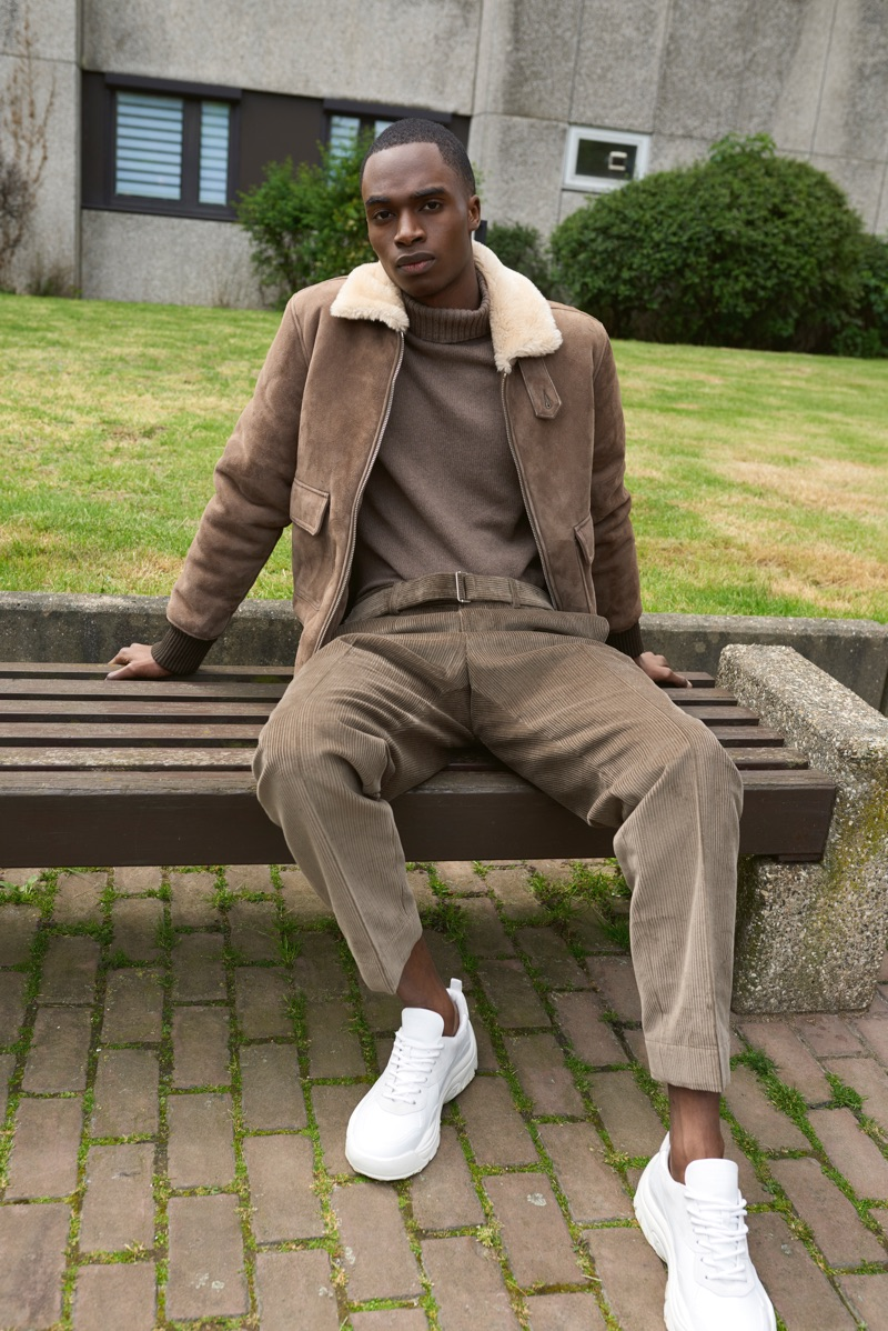 Embracing a monochromatic ensemble, Bakay Diaby wears an Officine Générale look with Valentino sneakers.