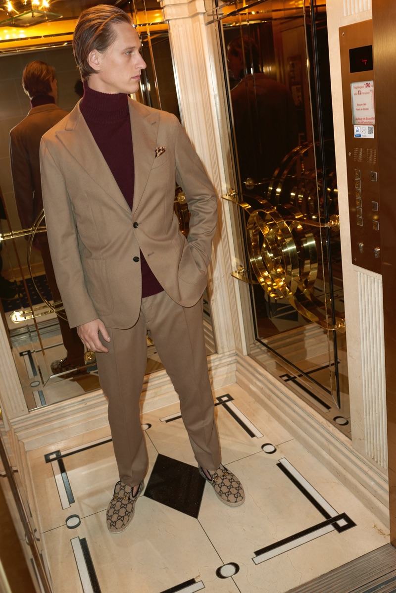 Donning neutrals, Rogier Bosschaart wears a Caruso suit and turtleneck sweater with Gucci loafers.