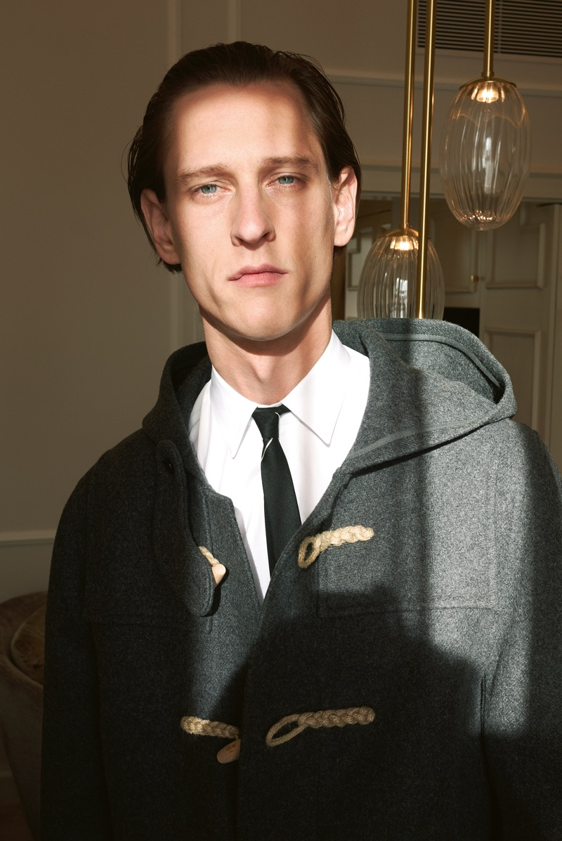 Rogier Bosschaart dons a duffle coat, shirt, and skinny tie by Celine.