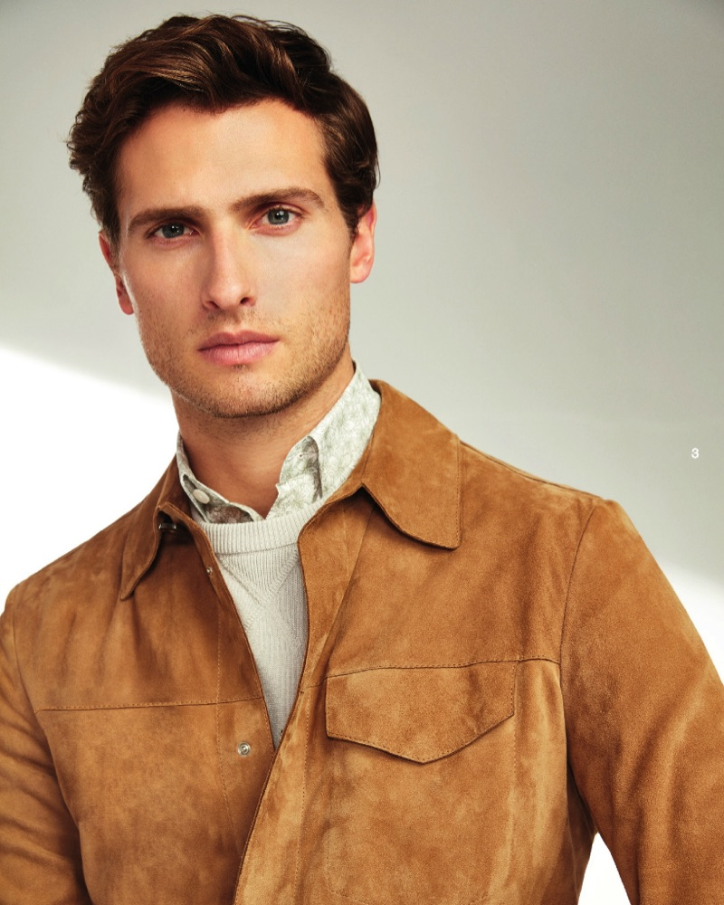 British model Tom Warren dons a brown suede jacket from Beymen Collection.