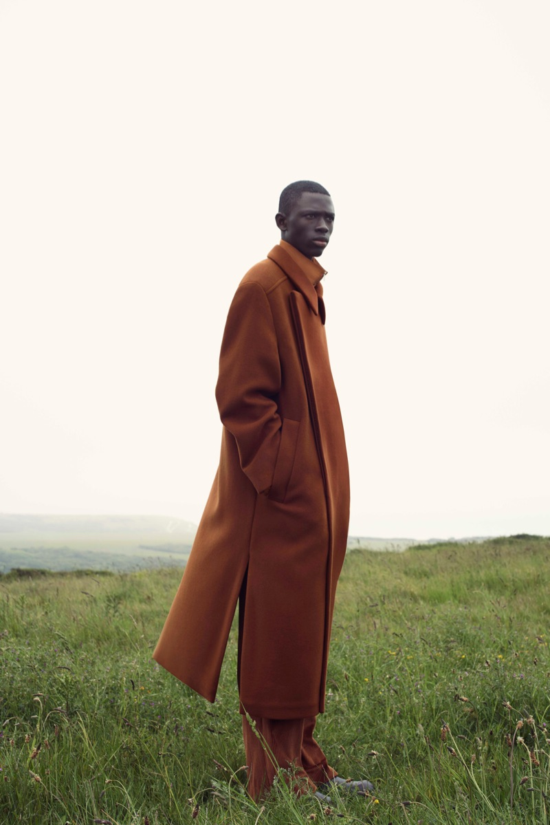 Photographed in the English countryside, Khadim Sock stars in COS' fall-winter 2019 campaign.