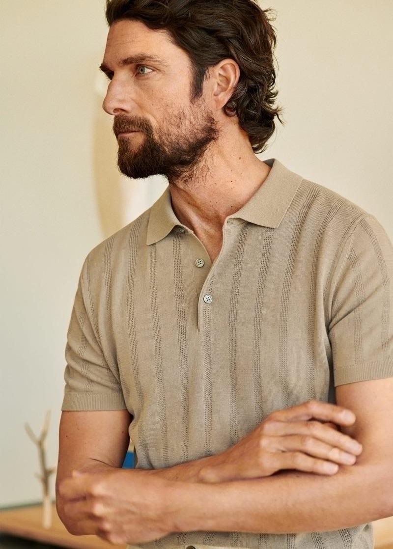 Model Cédric Bihr dons a chic knit polo from Mango Man.