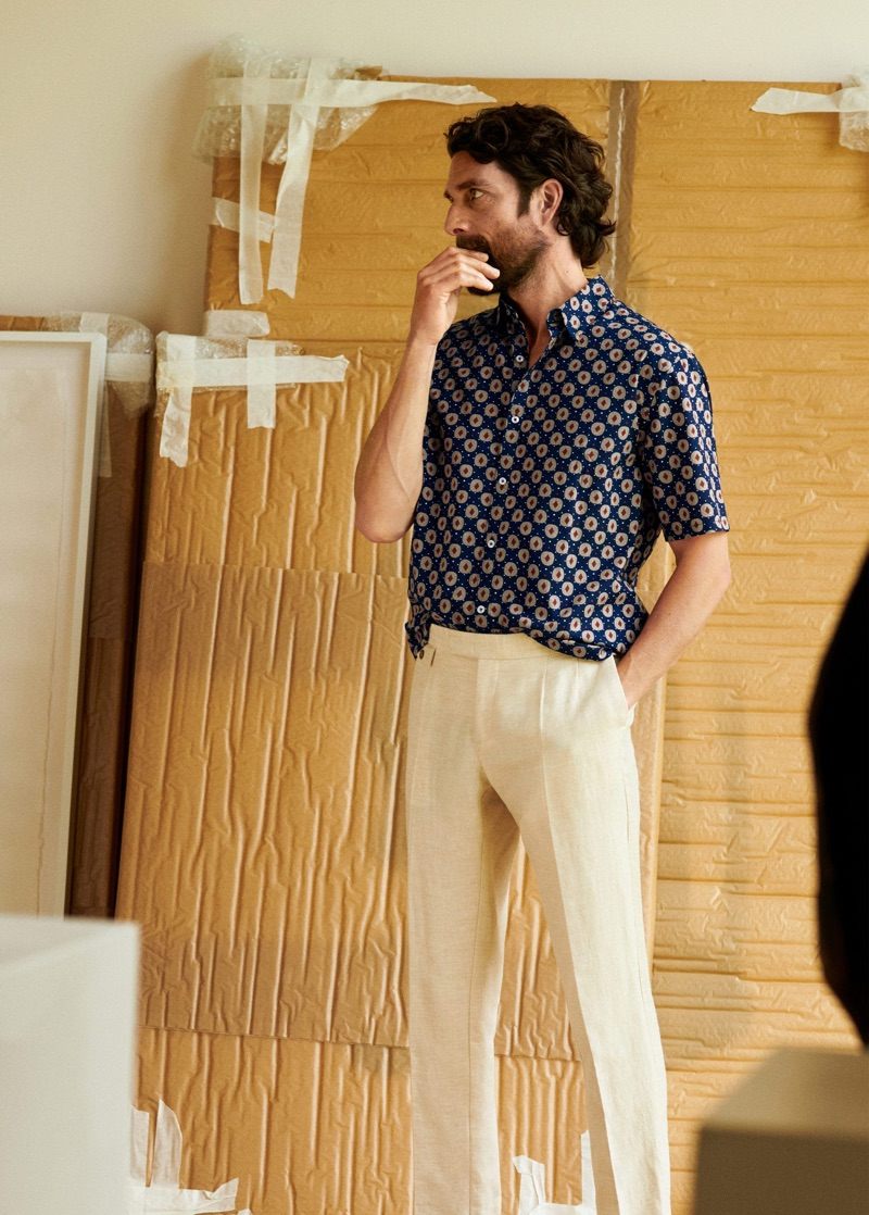Dressed for the season, Cédric Bihr sports a printed short-sleeve shirt with linen pants by Mango Man.