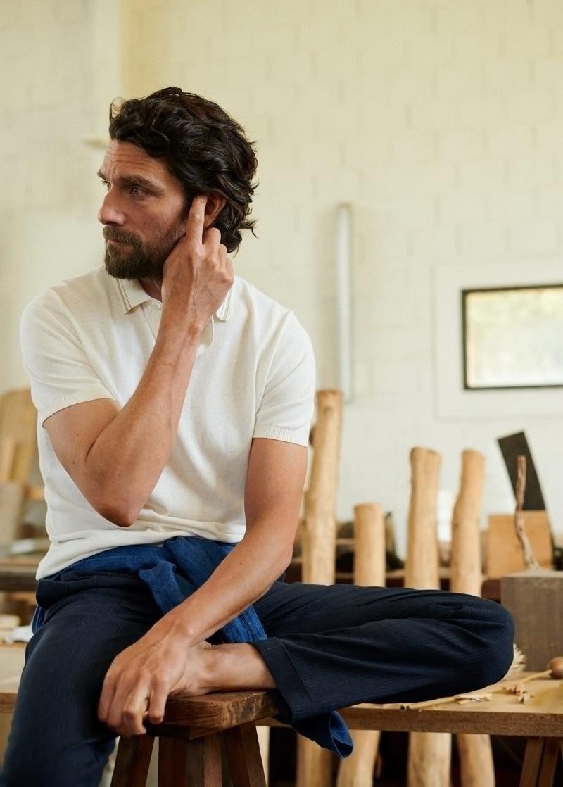 Relaxing, Cédric Bihr wears a look from Mango Man.