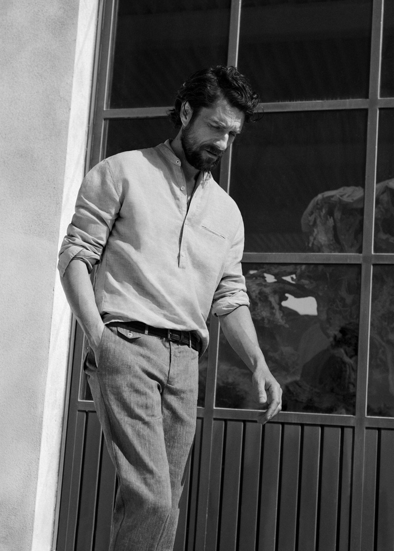Captured in a black and white photo, Cédric Bihr models an outfit by Mango Man.