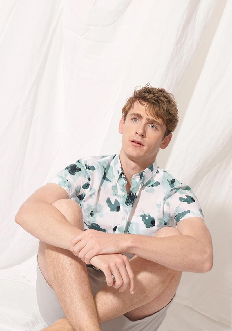 Embracing a graphic flair, Tom Webb dons Club Monaco's slim floral short-sleeve shirt $79.50.