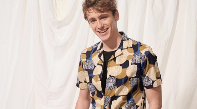 "All smiles, Tom Webb wears a Club Monaco notched collar moon print shirt $89.50 and 7"" shorts $89.50."